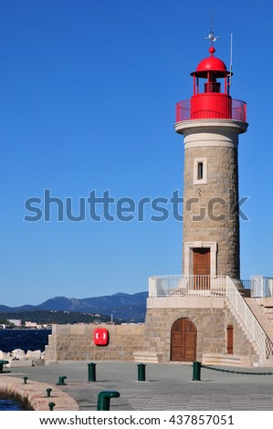 Saint Tropez; France - april 18 2016 : the red lighthouse in the port