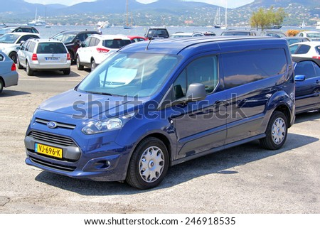 SAINT-TROPEZ, FRANCE - AUGUST 3, 2014: Blue cargo van Ford Transit Connect at the city street. - stock photo