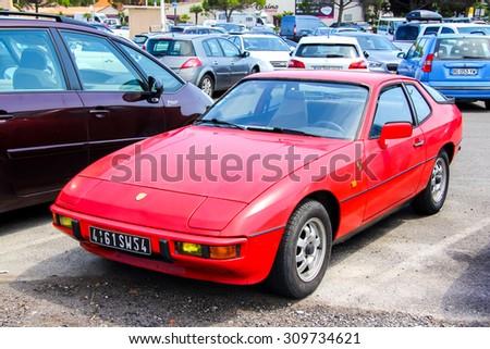 SAINT-TROPEZ, FRANCE - AUGUST 3, 2014: Motor car Porsche 924 at the city street. - stock photo