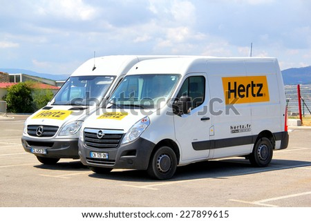 SAINT-TROPEZ, FRANCE - AUGUST 3, 2014: White cargo vans Opel Movano and Mercedes-Benz Sprinter at the city parking. - stock photo