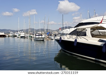 SAINT TROPEZ, FRANCE - SEPTEMBER 11, 2014: Modern super luxury yachts at port in St. Tropez, France. They are the toys of the famous and super rich. - stock photo