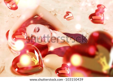 Saint Valentine day woman on the sand with flying hearts - stock photo