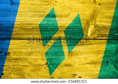 Saint Vincent and The Grenadines Flag painted on old wood plank texture