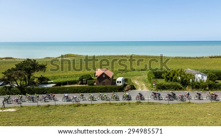 SAINTE-MARGUERITE-SUR-MER, FRANCE - JUL 09: The peloton riding near the beach in Normandy during the stage 6 of Le Tour de France 2015 on 09 July 2015. - stock photo