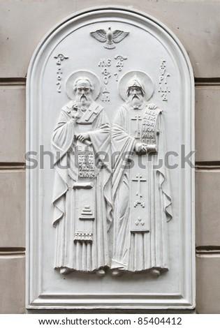 Saints Cyril and Methodius holding the Cyrillic alphabet - stock photo