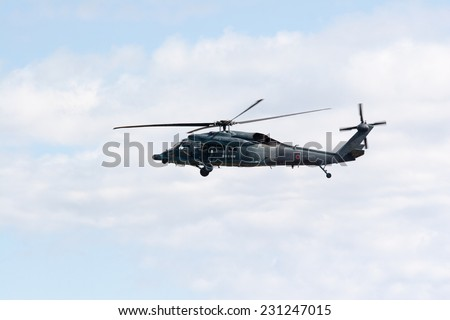 SAITAMA, JAPAN - NOVEMBER 3, 2014: Japanese Air Self-Defense Force holds their annual airshow at their Iruma airbase. They have a demonstration flight by a military rescue helicopter called UH-60J.