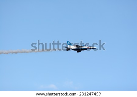 SAITAMA, JAPAN - NOVEMBER 3, 2014: Japanese Air Self-Defense Force holds their annual airshow at their Iruma airbase. They have a demonstration flight by an aerobatic team called Blue Impulse.