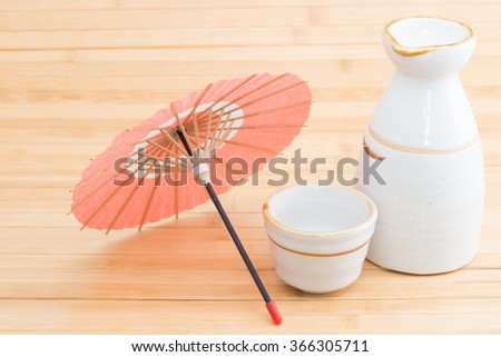 Sake and miniature of Japanese umbrella