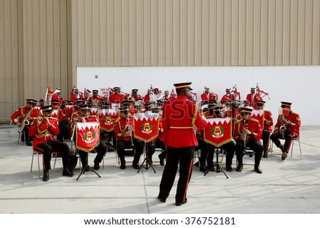 SAKHIR AIRBASE, BAHRAIN- JANUARY 21: Police band performs in the public area during Bahrain International Airshow at Sakhir Airbase, Bahrain on 21 January, 2016