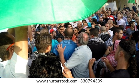 SAKHNIN, ISRAEL- OCTOBER 13: Havoc among Arab Israeli Muslim activists during anti Israel protest in demand liberation of Al Aqsa mosque and occupied territories