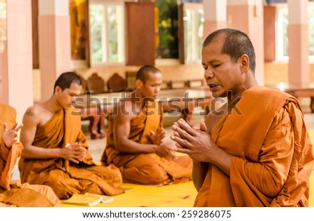 SAKONNAKHON,THAILAND December 23: Newly ordained Buddhist monk pray with priest procession. Newly ordained Buddhist monks have a ritual in the temple procession in December 23, 2012 - stock photo
