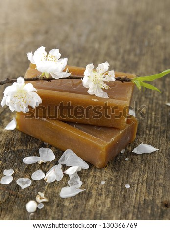 Sakura spring blossoms with stacked soap on old wooden