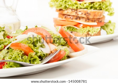 Salad and sandwiches. Selective focus - stock photo