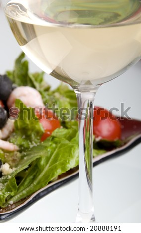Salad and wine isolated on white
