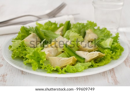 salad artichoke with lettuce on the plate