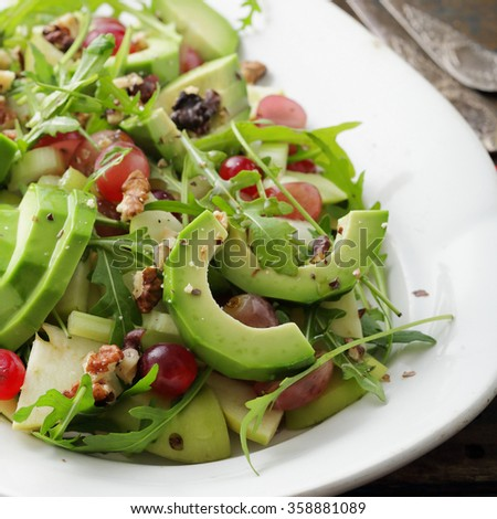 salad avocado with grapes and celery close-up - stock photo