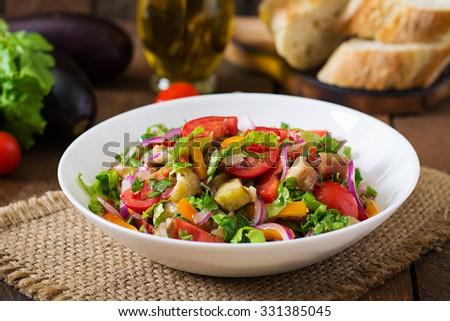 Salad  baked eggplant and fresh tomatoes - stock photo