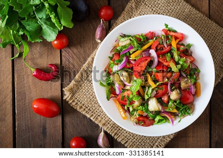 Salad  baked eggplant and fresh tomatoes. Top view - stock photo