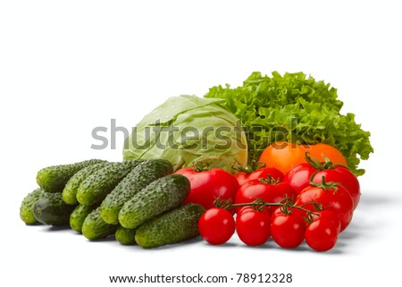 salad, cucumbers, cabbage and cherry tomatoes isolated on a white background