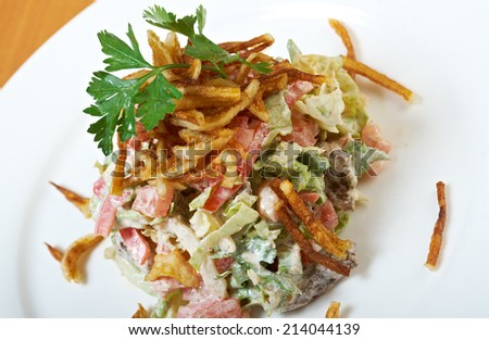 salad fried potatoes with vegetables and beef