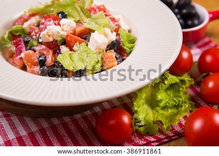 salad from feta cheese,olive,pepper,tomatoes and lettuce in studio
