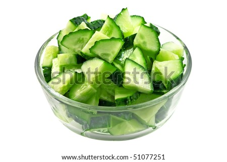 Salad from fresh cucumbers in glass bowl