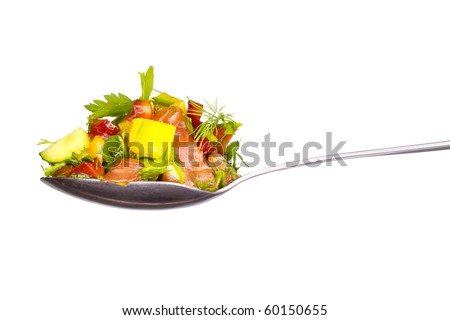 salad from fresh green-stuffs on a spoon