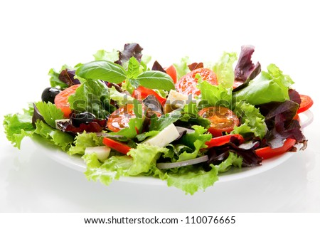 Salad from fresh vegetables, cheese mozzarella and olives, watered with olive oil - stock photo