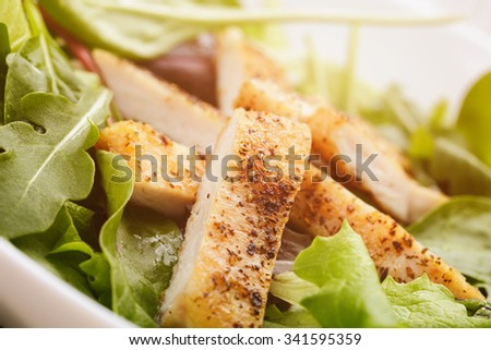 salad from mixed herbs and fried chicken, toned photo