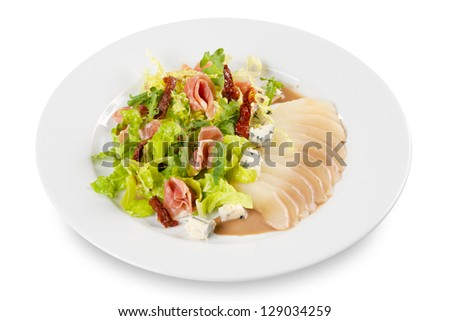 salad from pear, lettuce, chili, pepper, meat and cheese