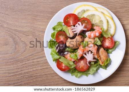 salad from seafood: shrimps, mussels, octopuses. close up on a table. top view.  - stock photo
