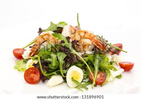 salad greens and shrimp on a white background in the restaurant - stock photo