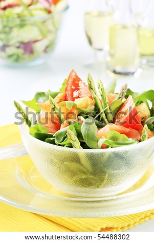 Salad greens with asparagus and smoked salmon   - stock photo