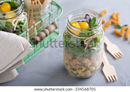 Salad in a jar with pasta and chickpeas food to go - stock photo