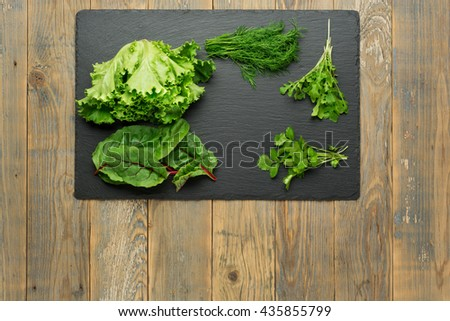 salad ingredients on stone kitchen board top view - stock photo