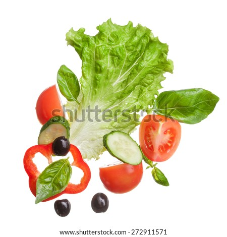 salad isolated in white - red tomatoes, pepper, basil, cucumber and olives, top view - stock photo