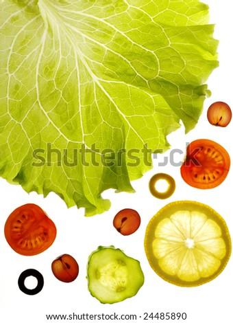 Salad, leaf, tomato, lemon, grapes, olive, cucumber on white - stock photo