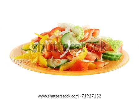 salad made up of fresh cut vegetables (tomato, cucumber, onion, sweet pepper and leaf lettuce), in orange glass plate, isolated on white - stock photo