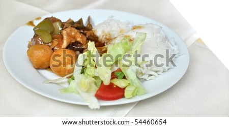 salad, meat balls, rice and vegetables
