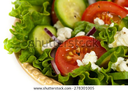 Salad. Mediterranean Salad with Feta Cheese on a white background. Selective focus. - stock photo
