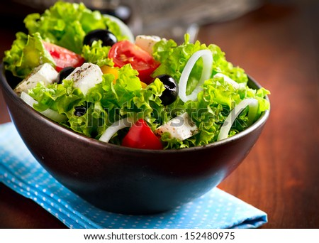 Salad. Mediterranean Salad with Feta Cheese, Tomatoes and Olives  - stock photo
