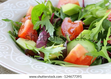 salad mix with avocado tomato and cucumber - stock photo