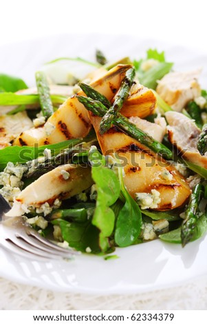 Salad mix with pears, grilled asparagus and blue cheese - stock photo