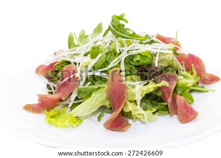 salad of arugula and tuna vegetables on a white background in the restaurant - stock photo