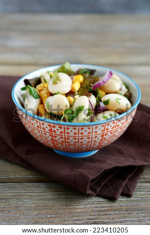 Salad of beans, onions, and corn in a bowl, nutrition food - stock photo