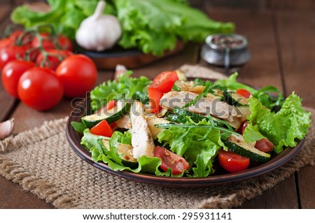 Salad of chicken breast with zucchini and cherry tomatoes - stock photo