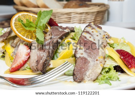 salad of duck meat and vegetables in a restaurant