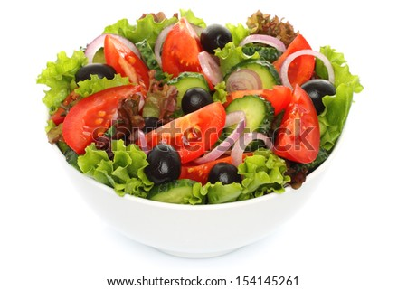 Salad of fresh vegetables on white background - stock photo