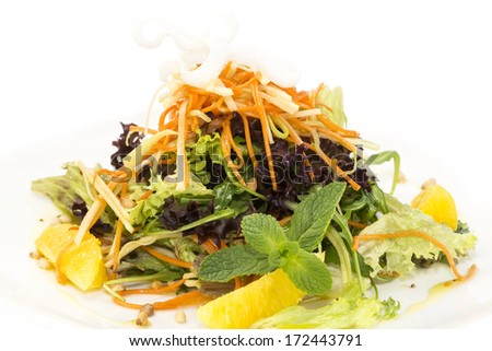 salad of fruit and vegetables on a white background in the restaurant