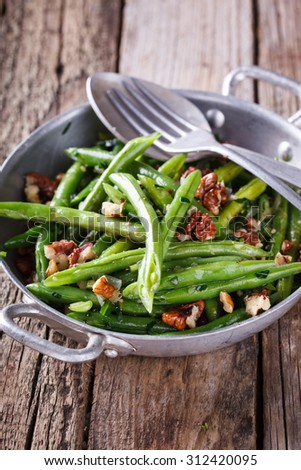Salad of green beans and walnut - stock photo